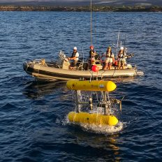 "Recovering AUV Sirius on Falkor's aft deck during the ""Coordinated Robotics"" 2018 expedition off the Hawaiian island of Maui."